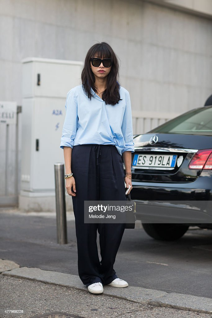 Editor Yoyo Lu exits the Salvatore Ferragamo show in an Acne top, Acne sunglasses, Giorgio Armani pants, and a Building Block bag on June 21, 2015 in Milan, Italy.