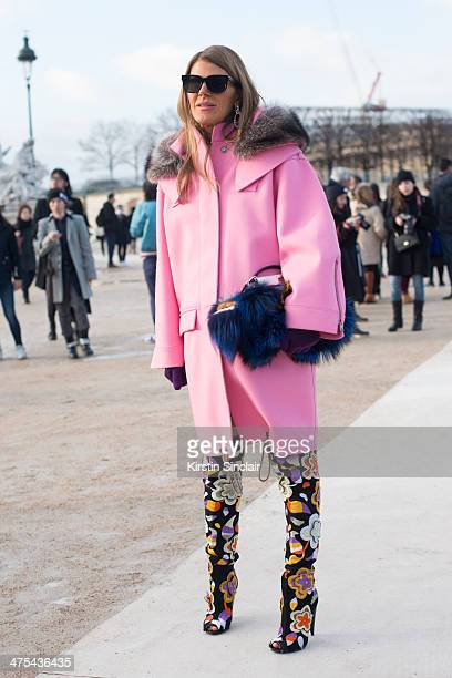 Editoratlarge and Creative Consultant for Vogue Japan Anna Dello Russo wears a Fendi bag and fendi Monster Miu Miu coat and sunglasses on day 3 of...