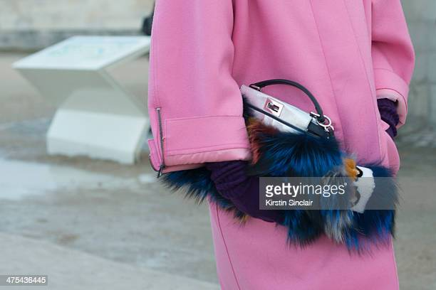 Editoratlarge and Creative Consultant for Vogue Japan Anna Dello Russo wears a Fendi bag and fendi Monster Miu Miu coat on day 3 of Paris Collections...