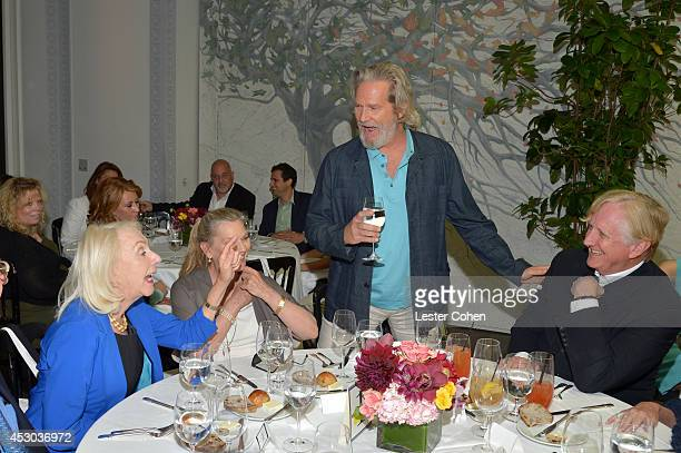 Editorial Director of AARP Media Myrna Blyth Susan Geston actor Jeff Bridges and musician T Bone Burnett attend the Jeff Bridges lunch hosted by AARP...