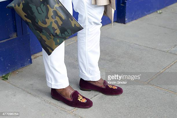 Editorial Director of GCaribbean magazine Geoff K Cooper wears Bonbos trousers Stubbs and wootton shoes Fendi bag on day 2 of London Collections Men...