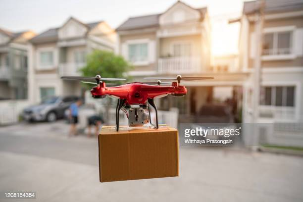 editorial on 23 february 2020, bangkok, thailand delivery drone flying in new york city - drone foto e immagini stock