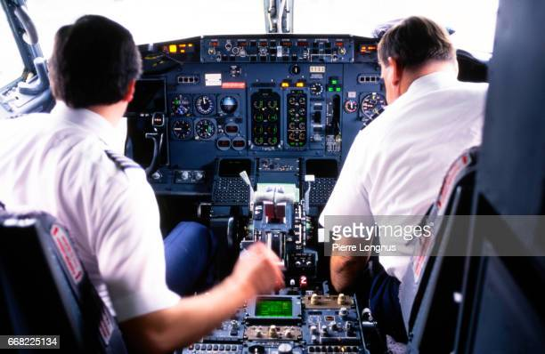 Editorial Use : Cockpit of a Boeing 737 with pilot and co-pilot doing last checks after landing in Las Vegas International Airport.