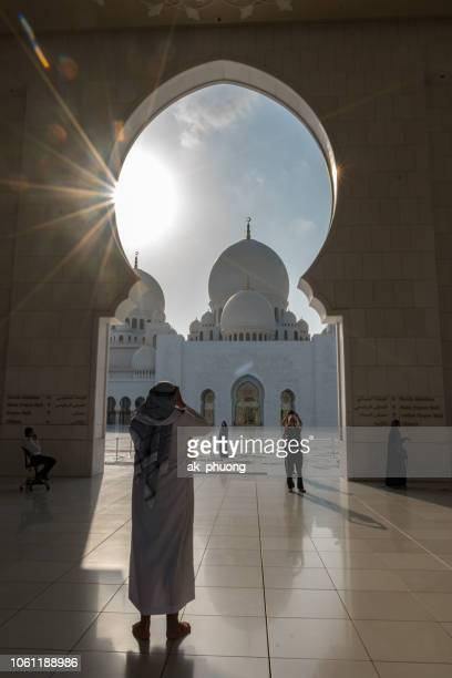 'editorial use only' the man taken picture of the mosque in the sunset - only men stockfoto's en -beelden