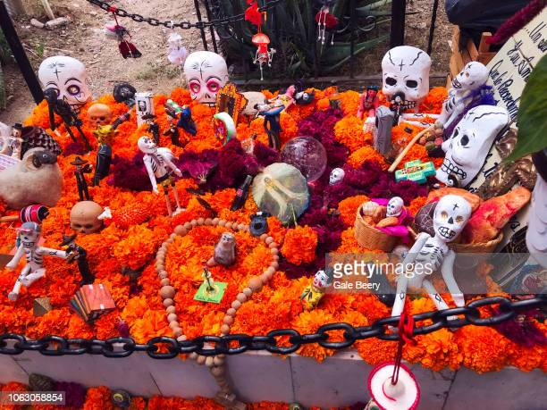 Editorial use-Day of the Dead grave With Skeletons and Marigolds