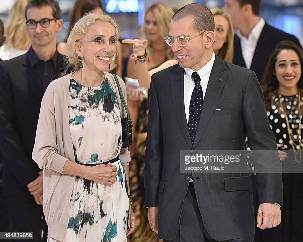 Editor-in Chief of Vogue Italia Franca Sozzani and Chairman and Chief Executive of Conde Nast International Jonathan Newhouse walk during the VIP...
