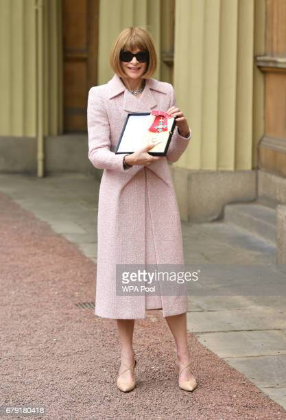 EditorinChief American Vogue and Artistic Director Dame Anna Wintour poses after receiving her Dame Commander from Queen Elizabeth II at an...