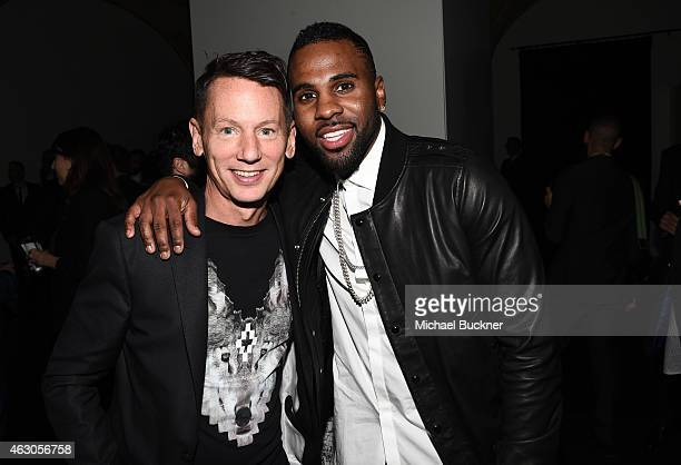 EditorinChief Jim Nelson and recording artist Jason Derulo attend GQ and Giorgio Armani Grammys After Party at Hollywood Athletic Club on February 8...
