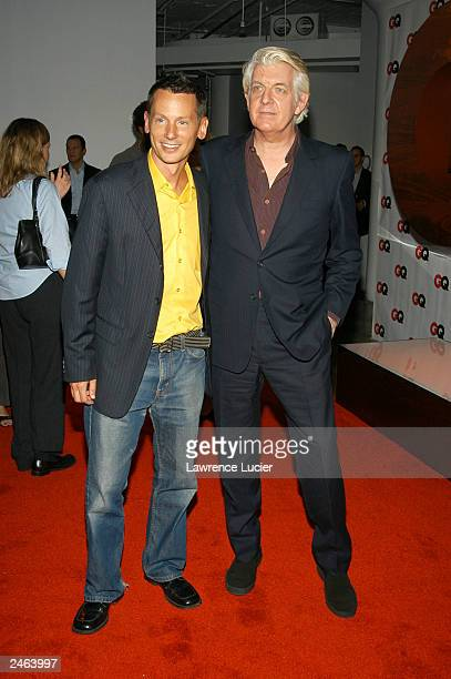 Editor-in-chief Jim Nelson poses with recording artist Nick Lowe arrive at the debut party for GQ's new editor-in-chief Jim Nelson at Hudson Studios...