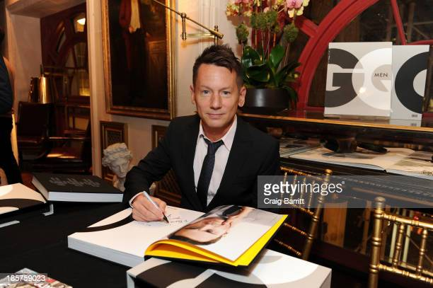 GQ editorinchief Jim Nelson signs his autograph at Martine and Prosper Assouline host Jim Nelson and Chris Mitchell to celebrate the launch of GQ Men...