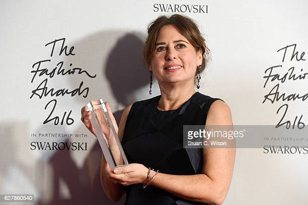 Editorinchief of British Vogue Alexandra Shulman poses in the winners room after winning the award for 100 Years of British Vogue at The Fashion...