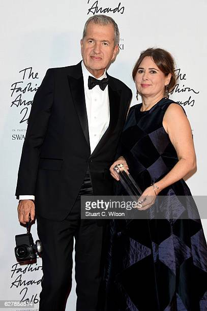Editorinchief of British Vogue Alexandra Shulman poses with photographer Mario Testino in the winners room after winning the award for 100 Years of...