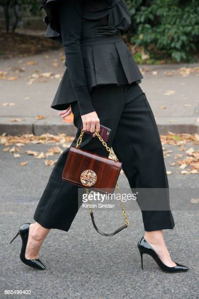 EditorinChief of Büro 24/7 Middle East Shannon Wylie wears a Style Keepers top Helmut Lang trousers Christian Louboutin shoes Tory Burch bag day 2 of...