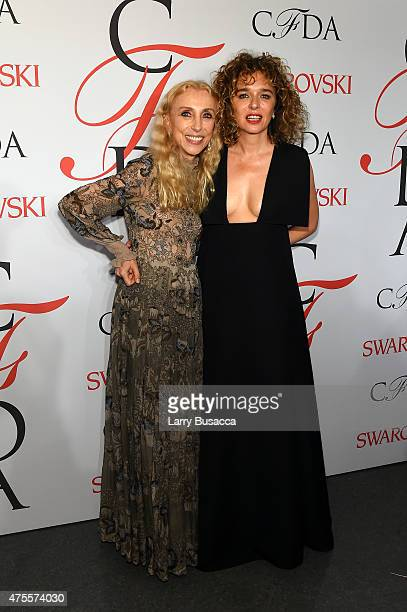 Editor-in-Chief of Italian Vogue, Franca Sozzani and actress Valeria Golino pose on the winners walk at the 2015 CFDA Fashion Awards at Alice Tully...