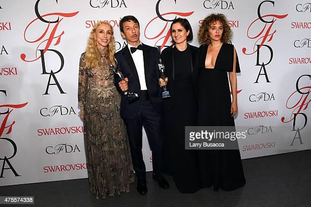 EditorinChief of Italian Vogue Franca Sozzani Designer Pierpaolo Piccioli actress Valeria Golino and designer Maria Grazia and pose on the winners...