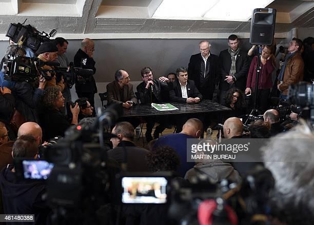 Editorinchief of Liberation Laurent Joffrin looks on as editorinchief of French satirical weekly Charlie Hebdo Gerard Briard French cartoonist Renald...