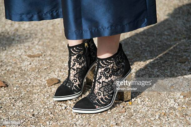 Editorinchief of Refinery 29 Christene Barberich is wearing Nicolas Kirkwood shoes and Tome coulottes on day 3 of Paris Collections Women on...