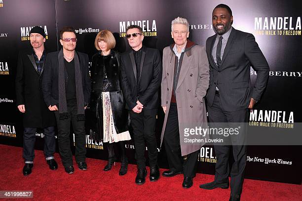 Editor-in-Chief of VOGUE magazine Anna Wintour poses with U2 band members : The Edge, Bono, Larry Mullen, Jr. And Adam Clayton and actor Idris Elba...