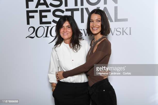 Editorinchief of Vogue Paris Emmanuelle Alt and Bella Hadid attend Vogue Fashion Festival Photocall At Hotel Potocki In Paris on November 15 2019 in...