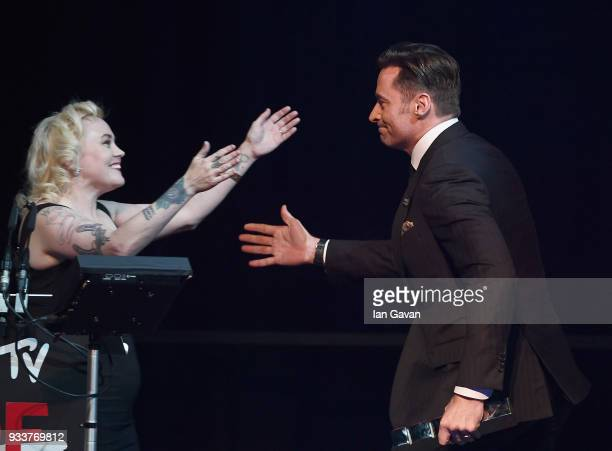 EditorinChief Terri White welcomes actor Hugh Jackman winner of the Best Actor award on stage during the Rakuten TV EMPIRE Awards 2018 at The...