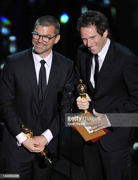 Editors Angus Wall and Kirk Baxter accept the Best Film Editing Award for 'The Girl with the Dragon Tattoo' onstage during the 84th Annual Academy...
