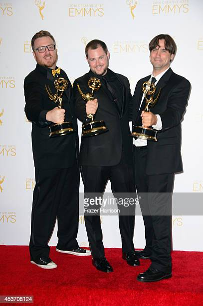 Editors Josh Earl Rob Butler and Art O'Leary pose in the press room during the 2014 Creative Arts Emmy Awards at Nokia Theatre LA Live on August 16...