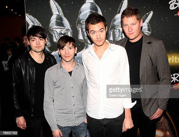 Editors members Chris Urbanowicz Ed Lay Tom Smith and Russ Leetch arrive at the BRITs Nominations Launch Party at the Roundhouse Camden on January 14...