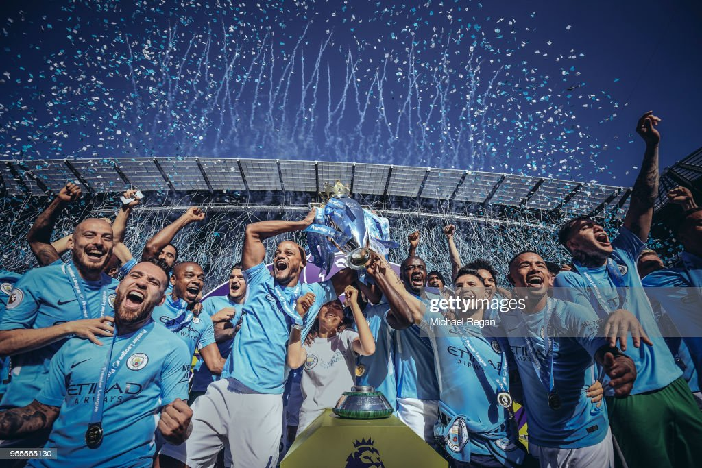 [Editor's note - digital filters were used in the creation of this image] Vincent Kompany and Sergio Aguero of Manchester City lift the Premier League trophy during the Premier League match between Manchester City and Huddersfield Town at Etihad Stadium on May 6, 2018 in Manchester, England.