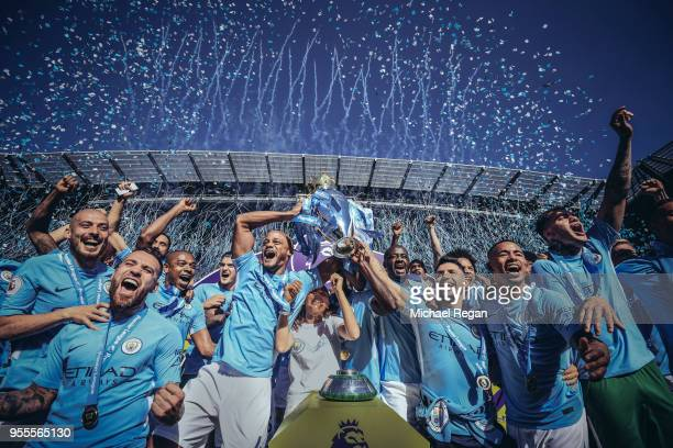 [Editor's note digital filters were used in the creation of this image] Vincent Kompany and Sergio Aguero of Manchester City lift the Premier League...
