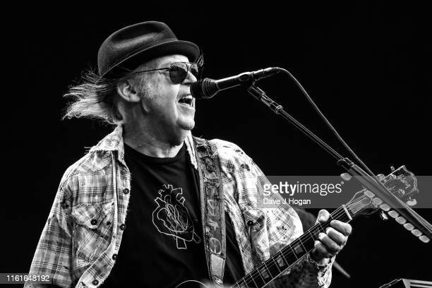 Editors note - image converted to black and white: Neil Young performs as part of a double bill with Bob Dylan at Hyde Park on July 12, 2019 in...