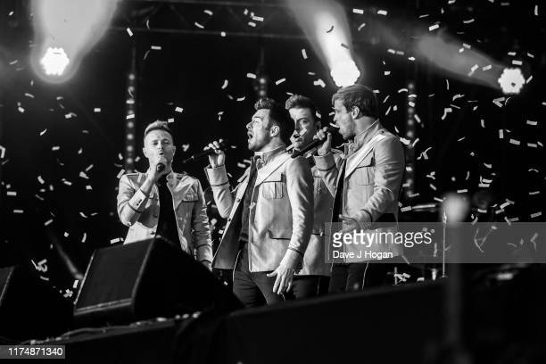 Editors note image converted to Black White Kian Egan Shane Filan Mark Feehily and Nicky Byrne of Westlife perform on stage during BBC2 Radio Live...