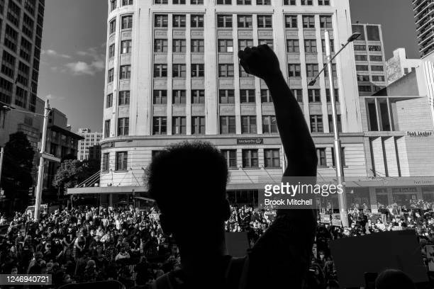 [Editors Note Image has been converted to black and white] A protester salutes the crowd at Town Hall on June 06 2020 in Sydney Australia Events...
