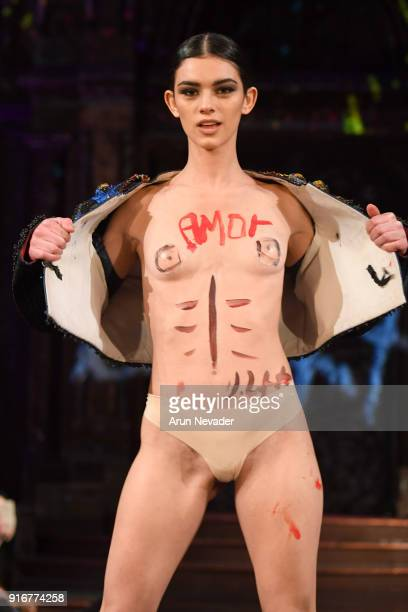 [Editor's Note Image may contain nudity] A model walks the runway during the Domingo Zapata presentation at New York Fashion Week Powered by Art...