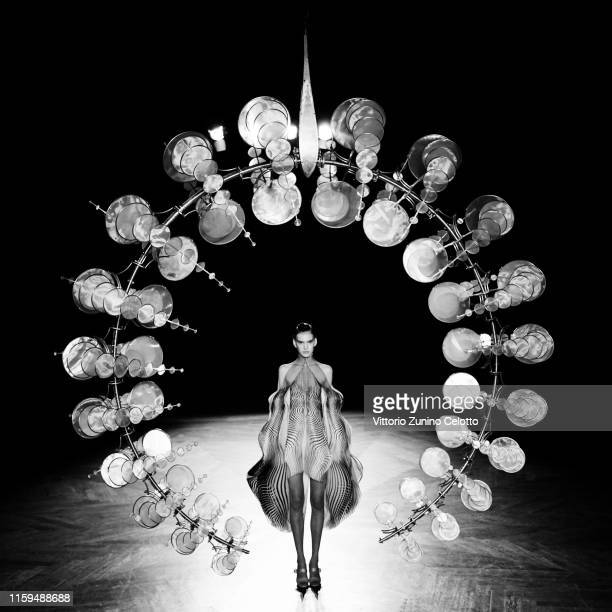 Editor's Note: Image was converted to black and white] A model walks the runway during the Iris Van Herpen fashion show on July 01, 2019 in Paris,...