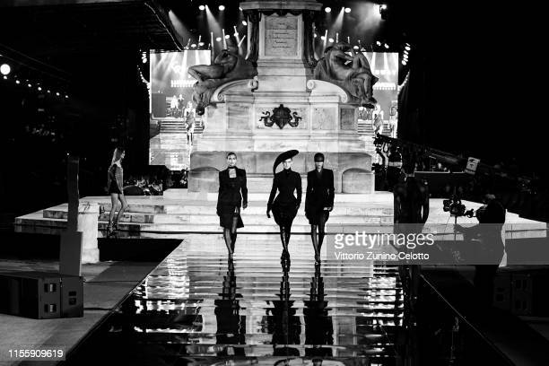 [Editor's Note Image was converted to black and white] Irina Shayk Bella Hadid and Joan Smalls walk the CR Runway x Luisaviaroma during Pitti...