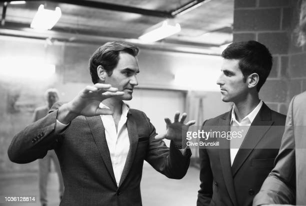 Editors Note Image was converted to Black and White Roger Federer and Novak Djokovic of Team Europe talk together as they wait backstage to be...