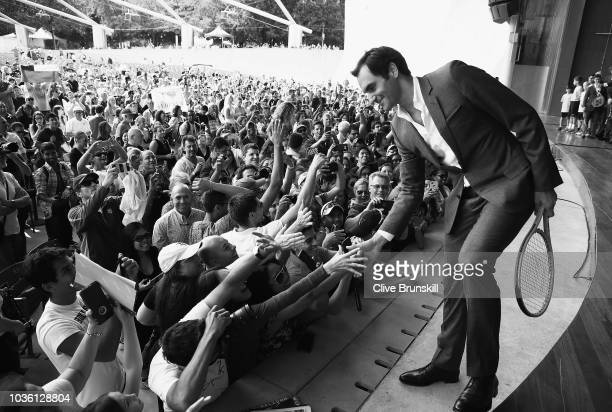 Editors Note Image was converted to Black and White Roger Federer meets the crowd at the official welcome ceremony prior to the Laver Cup at the...