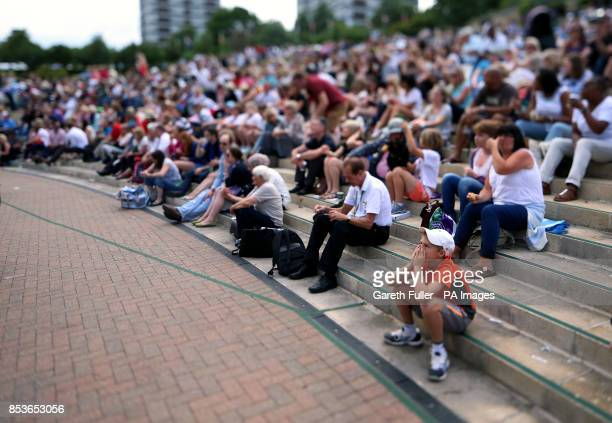 Shot using a tilt/shift lens* Fans on Murray Mount watch the match between Great Britain's Heather Watson and Germany's Angelique Kerber on the big...