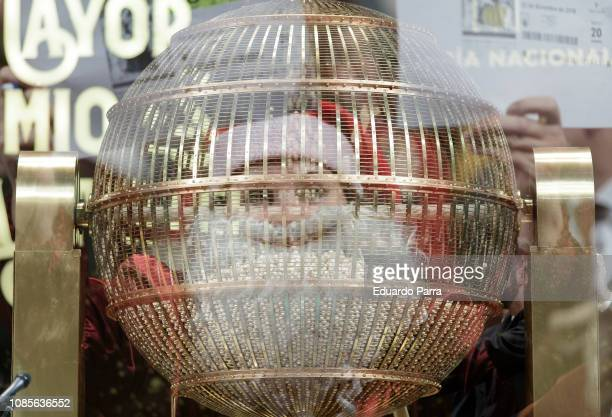 [Editor's note This image has been taken in a multiexposure mode in camera] A person in a costume of Santa Claus attends the draw of Spain's...