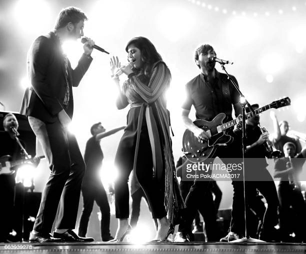 [Editor's note This image was converted to black and white] Singers Charles Kelley Hillary Scott and Dave Haywood of Lady Antebellum perform onstage...