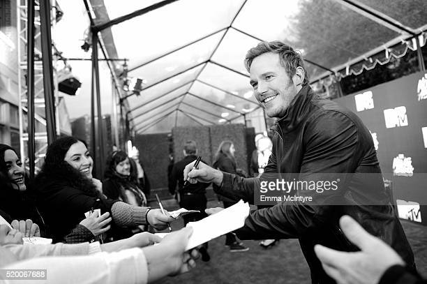 [Editor's note This image was shot in black and white] Actor Chris Pratt signs autographs before the 2016 MTV Movie Awards at Warner Bros Studios on...