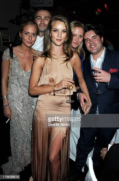 Editor's Special Award winner Rosie HuntingtonWhiteley and guests Sophie Green and Michael Evans attends an after party following the Glamour Women...