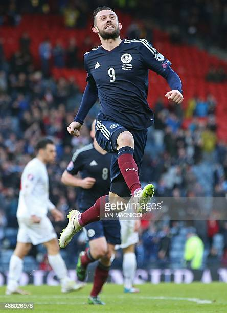 Editors this is third goal celebration not second ** Scotland's striker Steven Fletcher celebrates after he scores his third goal during the Euro...