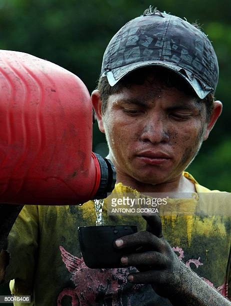 Edivaldo Albuquerque a resident of Tailandia takes a moment to drink some water as he loads an oven with rests of wood to produce charcoal on the...