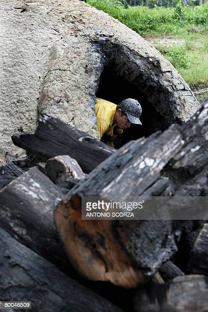 Edivaldo Albuquerque a Tailandia resident loads an oven with wood chips to make charcoal in the outskirts of Tailandia Para northern Brazil on...