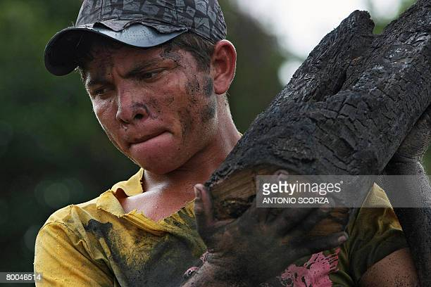 Edivaldo Albuquerque loads an oven with wood to produce charcoal in Tailandia Para northen Brazil on February 27 2008 The Brazilian government...