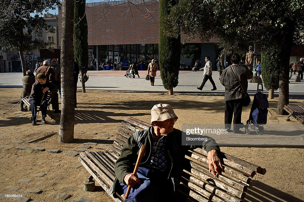 Edlerly men sit and rest on public benches in the city park in Figueres, Spain, on Thursday, Jan. 31, 2013. Spain's recession deepened more than economists forecast in the fourth quarter as the government's struggle to rein in the euro region's second-largest budget deficit weighed on domestic demand. Photographer: David Ramos/Bloomberg via Getty Images