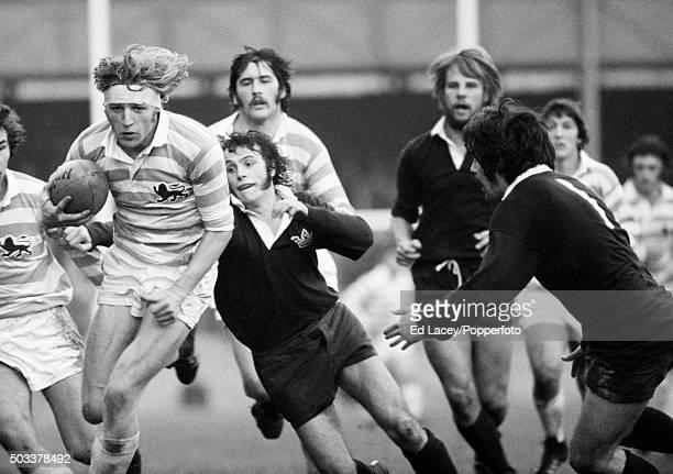 SRR Edlmann of Cambridge University runs through the Oxford defence during the annual Varsity match at Twickenham in London 9th December 1975