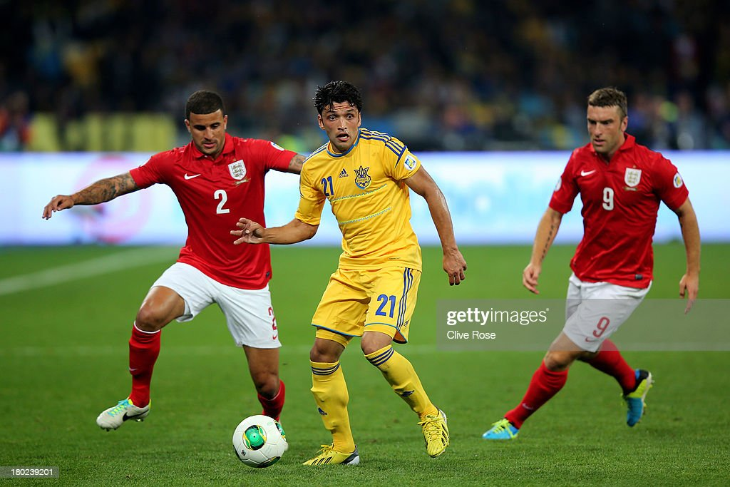 Edmar of Ukraine is pursued by Kyle Walker and Ricky Lambert of England during the FIFA 2014 World Cup Qualifying Group H match between Ukraine and England at the Olympic Stadium on September 10, 2013 in Kiev, Ukraine.