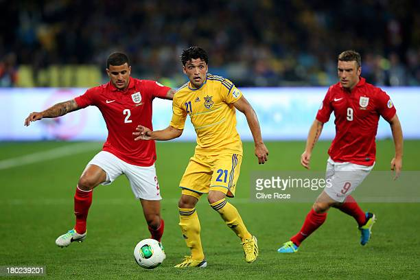 Edmar of Ukraine is pursued by Kyle Walker and Ricky Lambert of England during the FIFA 2014 World Cup Qualifying Group H match between Ukraine and...